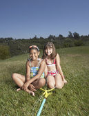 Young girls smiling for the camera — Stock Photo