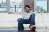 Portrait of man sitting on couch — Stock Photo