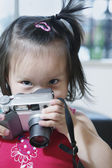 Portrait of young girl with camera — Stock Photo