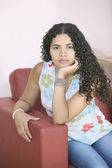 Young woman posing in armchair — Stock Photo