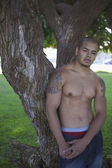 Portrait of bare chested man with tattoos — Stock Photo