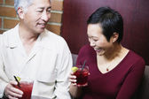 Couple having drinks together — Stock Photo