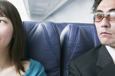 Adult couple traveling in an airplane — Stock Photo