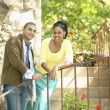 Portrait of couple on stairs outdoors - 