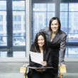 Two businesswomen looking at camera — Stock Photo #18726807