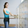 Stock Photo: Womstanding by library file drawer