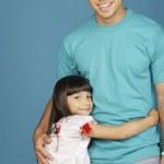 Young girl and young man smiling at camera — Stock Photo