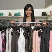 Young woman clothes shopping — Stock Photo