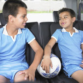 Brothers in car with soccer ball — Stock Photo