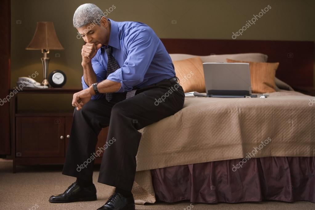 Businessman checking the time in his hotel room  Stock Photo #18727031