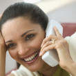 Close up of woman talking on telephone - Stock Photo