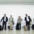 Royalty-Free Stock Photo: Portrait of businesspeople at airport with luggage