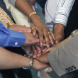 Hands of businesspeople in huddle — Stock Photo