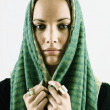 Portrait of woman with head covering — Stock Photo