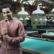 Portrait of man in pool hall — Stock Photo