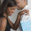 Couple with gift bag — Stock Photo #23218684