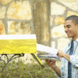 Man getting mail from mailbox - Stock Photo