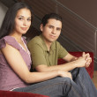 Portrait of couple sitting on couch together — Stock Photo