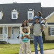Stock Photo: Portrait of family in front of house