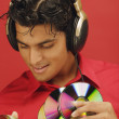 Man listening to music and holding discs — Foto de Stock