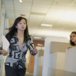 Businesswoman running at office — Stock Photo