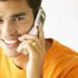 Portrait of man talking on cell phone - Stock Photo