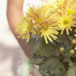 Stock Photo: Midsection of girl holding flowers