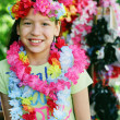 Young girl in flower necklaces and headdress — Stock Photo