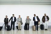 Portrait of businesspeople at airport with luggage — Stock Photo