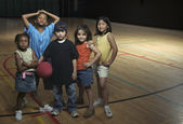 Portrait of group of children with basketball — Stock Photo