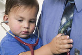 Young boy wearing stethoscope — Stock Photo