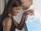 Couple with gift bag — Stock Photo
