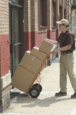 Side view of delivery man with boxes — Stock Photo