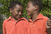 Two twin brothers smiling — Stock Photo