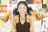 Portrait of teenage girl holding high heel shoes — Stock Photo