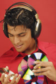 Man listening to music and holding discs — Stock Photo