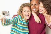 Group taking self portrait with camera — Stock Photo