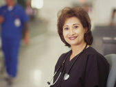 Portrait of female doctor smiling — Stock Photo