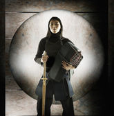 Portrait of woman fencing — Stock Photo