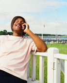Young man using cell phone on at waterfront — Stock Photo