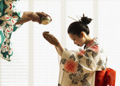 Man pouring woman in kimono tea — Stock Photo