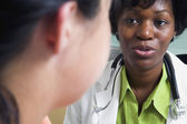 Close up of female doctor talking to patient — Stock Photo