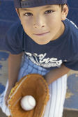 Portrait of boy with baseball and baseball glove — Stock Photo