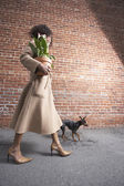 Side view of woman walking dog — Stock Photo