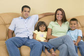 Family relaxing on sofa — Stock Photo