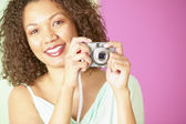 Portrait of woman holding camera — Stock Photo