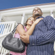 Stock Photo: Couple standing on porch
