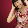 Woman listening to music with headphone — Stock Photo
