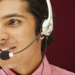 Close up of man with headset - Stock Photo