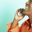 Man laughing while talking on cell phone - Stock Photo